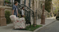 Bruce Almighty - 3 - Jim Carrey on Brownstone Street with a sofa (still from DVD release)