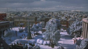Gremlins - Stills - 1 - Still from the opening of the movie featuring a gorgeous matte painting of the town of Kingston Falls, featuring Courthouse Square in the foreground.
