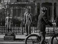 Harvey - Stills - 1 - Still from Harvey - James Stewart as Elwood P. Dowd outside his home on Colonial Street (1950))