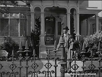 Harvey - Stills - 2 - Still from Harvey - James Stewart as Elwood P. Dowd outside his home on Colonial Street (1950)