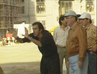Newsies Stills - 4 - Director Kenny Ortega lining up a shot on New York Street (still from DVD featurette, 1991)